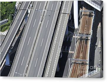 Road And Rail Intersection Canvas Print by Andy Smy