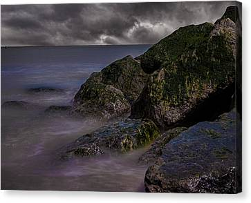 Rock Faces Canvas Print by Martin Newman