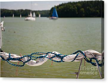 Rolled Up Mast Sail Material Canvas Print by Arletta Cwalina