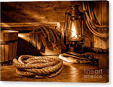 Rope And Tools In A Barn - Sepia Canvas Print by Olivier Le Queinec