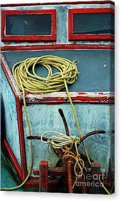 Ropes And Rusty Anchors On A Boat Deck Canvas Print by Sami Sarkis