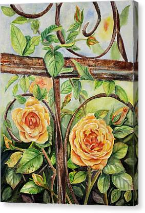 Roses At Garden Fence Canvas Print by Patricia Pushaw