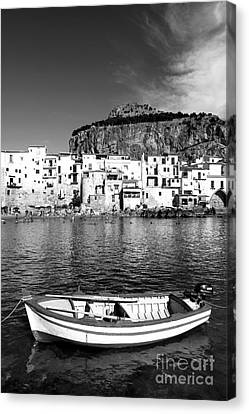 Rowboat Along An Idyllic Sicilian Village. Canvas Print by Stefano Senise