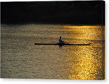 Rowing At Sunset Canvas Print by Bill Cannon
