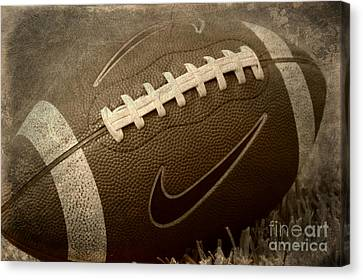 Rustic Football Canvas Print by Amy Steeples