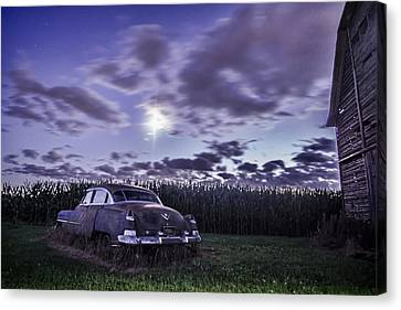 Rusty Old Cadillac In The Moonlight Canvas Print by Sven Brogren