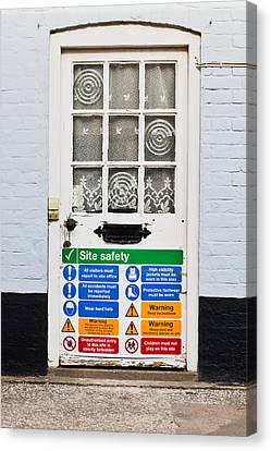 Safety Sign Canvas Print by Tom Gowanlock