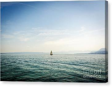 Sailboat On Lake Geneva. Switzerland. Canvas Print by Bernard Jaubert