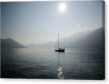 Sailing Boat In Alpine Lake Canvas Print by Mats Silvan