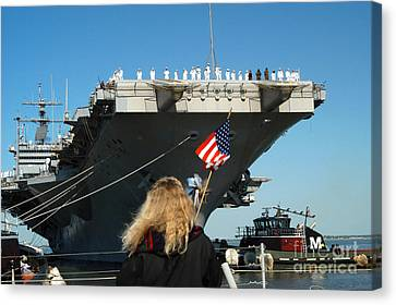 Sailors Aboard Aircraft Carrier Uss Canvas Print by Stocktrek Images