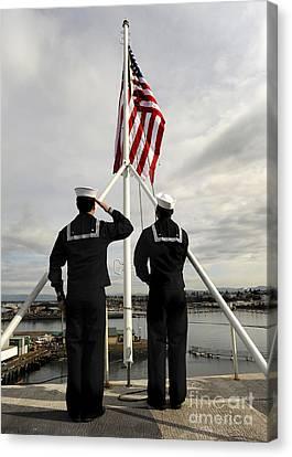 Sailors Raise The National Ensign Canvas Print by Stocktrek Images