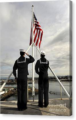 Sailors Raise The National Ensign Canvas Print by Stocktrek Images