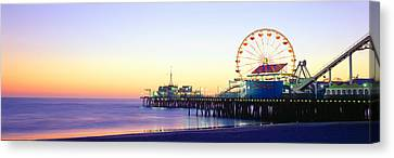 Santa Monica Pier At Sunset, California Canvas Print by Panoramic Images