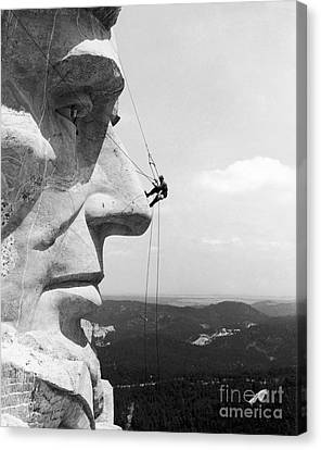 Scaling Mount Rushmore Canvas Print by Granger