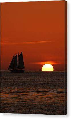 Schooner In Red Sunset Canvas Print by Susanne Van Hulst