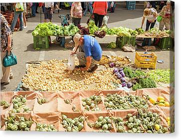 Selling Onions On A Market Canvas Print by Patricia Hofmeester