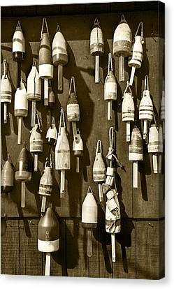 Sepia Toned Fishing Buoys In Maine Canvas Print by Randall Nyhof
