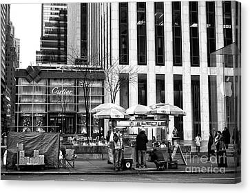 Setting Up On 5th Avenue Canvas Print by John Rizzuto