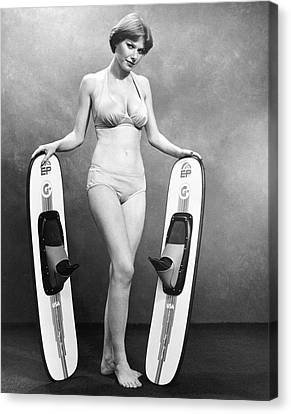 Sexy Woman Advertises Skis Canvas Print by Underwood Archives
