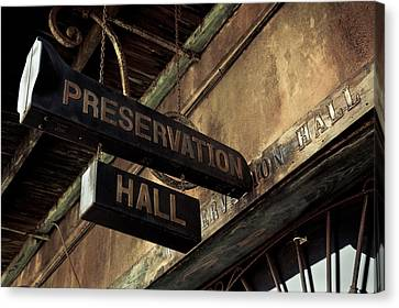 Signboard On A Building, Preservation Canvas Print by Panoramic Images
