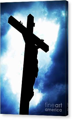 Silhouetted Crucifix Against A Cloudy Sky Canvas Print by Sami Sarkis