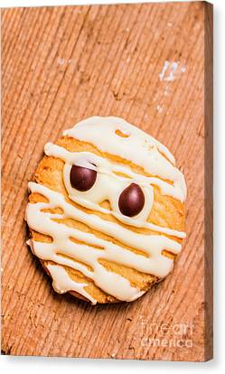 Single Homemade Mummy Cookie For Halloween Canvas Print by Jorgo Photography - Wall Art Gallery
