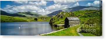 Skies Over Snowdon Canvas Print by Adrian Evans