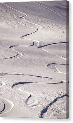 Skiing Tracks Canvas Print by John Foxx