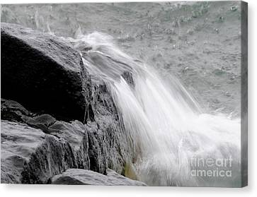 Slow Motion Wave Runoff Canvas Print by Sandra Updyke