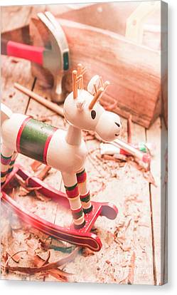 Small Xmas Reindeer On Wood Shavings In Workshop Canvas Print by Jorgo Photography - Wall Art Gallery