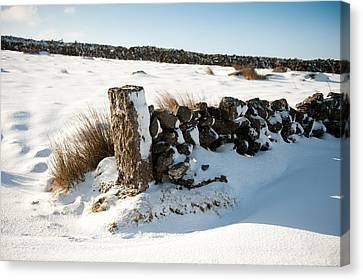 Snow Covered Gatepost Canvas Print by Helen Northcott