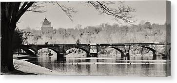 Snow On The River Canvas Print by Bill Cannon