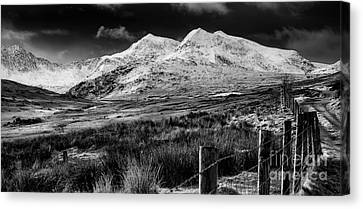 Snowdon Winter Canvas Print by Adrian Evans