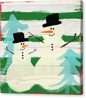 Snowmen With Blue Trees- Art By Linda Woods Canvas Print by Linda Woods