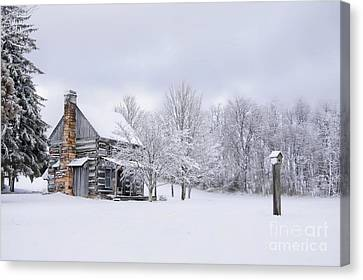 Snowy Cabin Canvas Print by Benanne Stiens