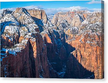 Snowy Cliffs Of Zion National Park Canvas Print by James Udall