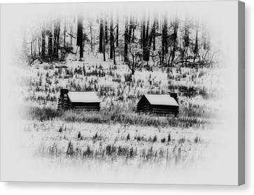 Snowy Log Cabins At Valley Forge Canvas Print by Bill Cannon