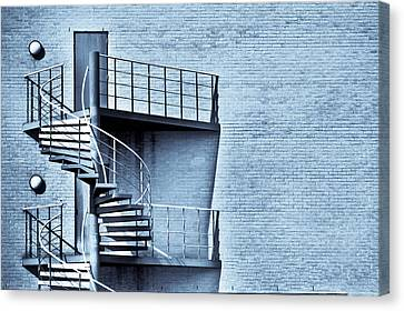 Spiral Stairs Canvas Print by Tom Gowanlock