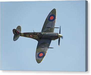 Spitfire Mk9 Canvas Print by Ian Merton
