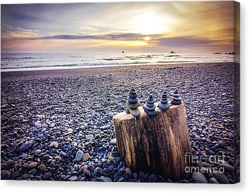 Stacked Rocks At Sunset Canvas Print by Joan McCool
