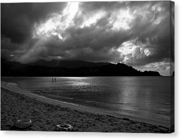 Stand Up Paddlers In Stormy Skies Canvas Print by Lennie Green