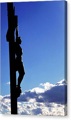 Statue Of Jesus Christ On The Cross Against A Cloudy Sky Canvas Print by Sami Sarkis
