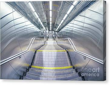 Stepping Down To The Underground Canvas Print by Evelina Kremsdorf
