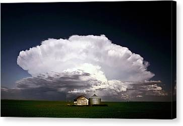 Storm Clouds Over Saskatchewan Granaries Canvas Print by Mark Duffy