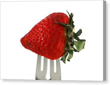 Strawberry On A Fork Canvas Print by Michael Ledray