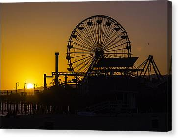 Sun Setting Beyond Ferris Wheel Canvas Print by Garry Gay