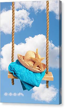 Sunhat On Swing Canvas Print by Amanda Elwell
