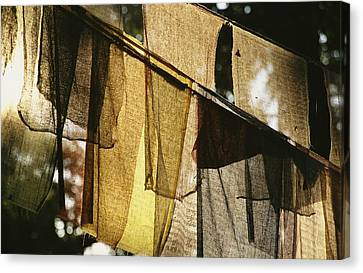 Sunlight Filters Through Prayer Flags Canvas Print by Michael Melford