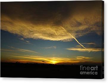 Sunrise And Clouds  Canvas Print by Joyce Woodhouse