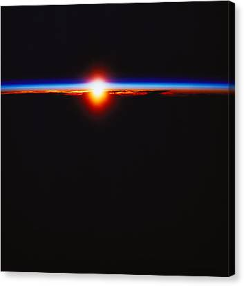 Sunrise Viewed From Space Canvas Print by Stockbyte